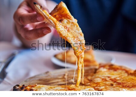 Sliced Pizza on a wooden cutting board, selective focus Stock photo © milsiart