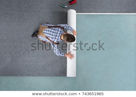 Charpentier tapis mains main Photo stock © AndreyPopov