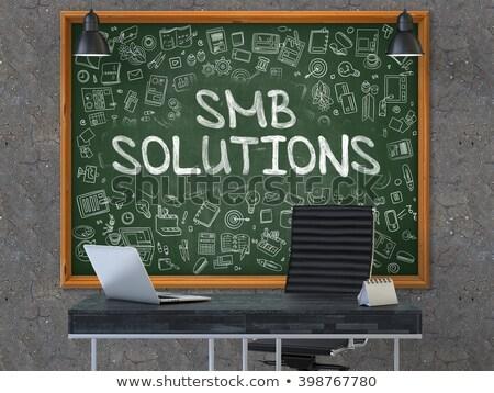 smb solutions   hand drawn on green chalkboard stock photo © tashatuvango