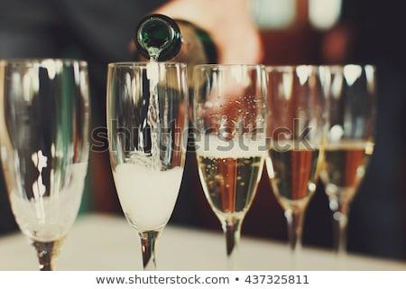 Esküvő buli áramló pezsgő nő fal Stock fotó © IS2