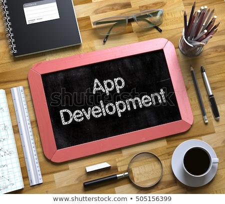 app development on small chalkboard 3d stock photo © tashatuvango