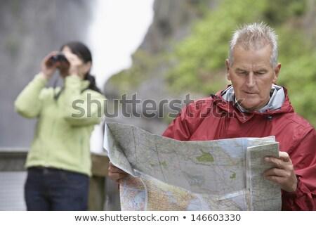 Homem maduro olhando mapa natureza beleza segurança Foto stock © IS2