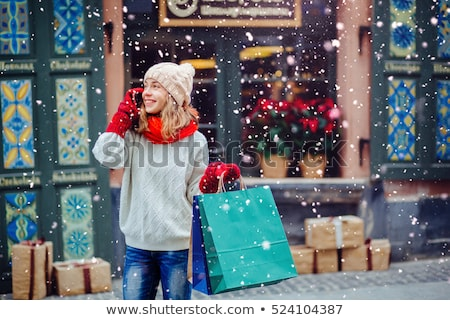 Woman in scarf and mittens talking on phone Stock photo © LightFieldStudios