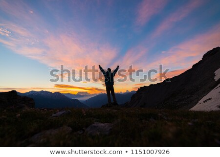 climbing or hiking success with arms outstretched in mountains stock photo © blasbike