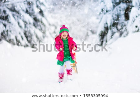 Girl jumping, running in snow Stock photo © IS2