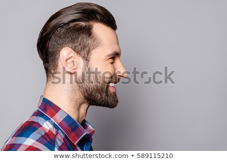 вид сбоку лице портрет улыбаясь бородатый Сток-фото © deandrobot