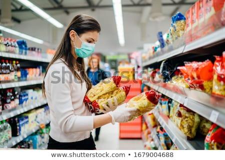 Pas cher épicerie heureux femme longtemps réception Photo stock © stokkete