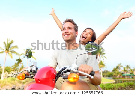 Young asian couple on moped Stock photo © IS2