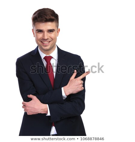 businessman in navy suit points finger and looks to side Stock photo © feedough