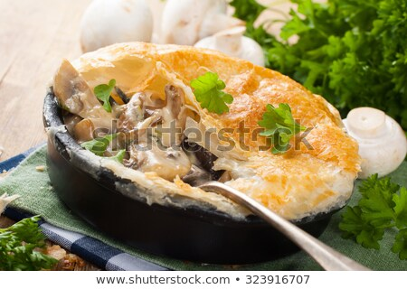 Stewed mushrooms under puff pastry. Stock photo © Melnyk