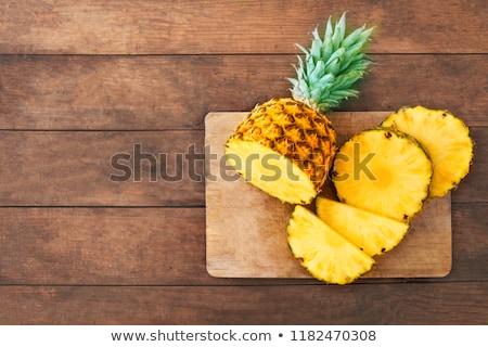 Half of pineapple on yellow wood Stock photo © dash
