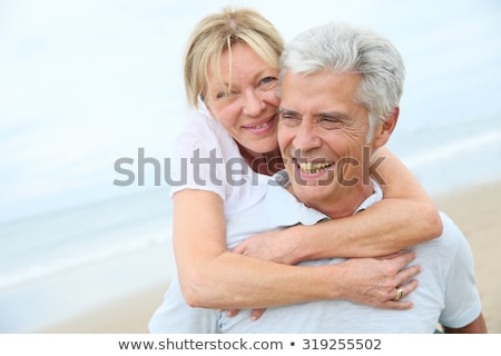 Boldog férfi háton feleség tengerpart portré Stock fotó © AndreyPopov