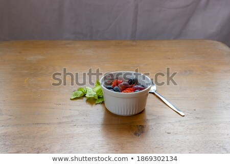 Fresh raw organic blueberries with leaf on wooden spoon on white background. Food concept.  Stock photo © DenisMArt