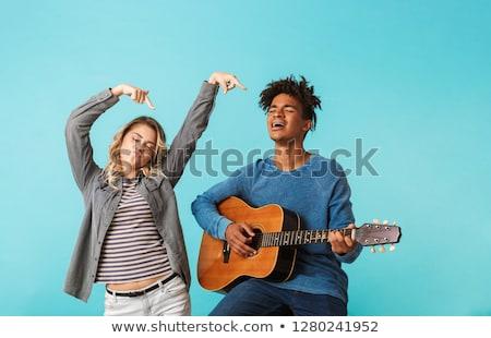 gelukkig · luisteren · naar · muziek · smartphone · park · glimlachend - stockfoto © deandrobot