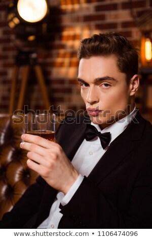 young elegant man wearing tuxedo and bowtie Stock photo © feedough