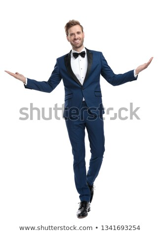 laughing young man in tuxedo and bow tie is walking Stock photo © feedough