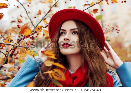 Close up portrait of a young woman with red hat and scarf Stock photo © MikhailMishchenko