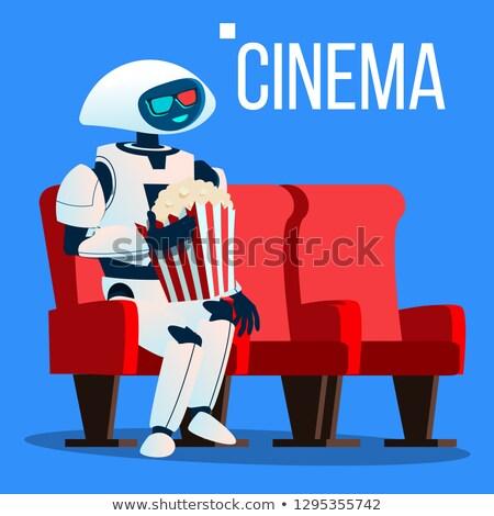 Robô cadeira cinema óculos 3d pipoca mãos Foto stock © pikepicture