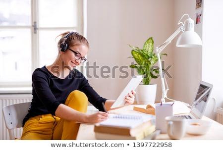 kadın · oturma · odası · dinleme · kulaklık · gülümseyen · kadın · gülen - stok fotoğraf © dolgachov