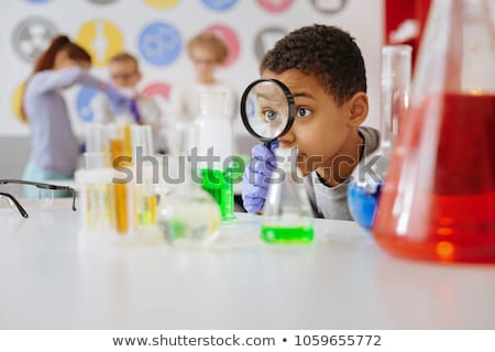 kids with flask and magnifier at chemistry class Stock photo © dolgachov