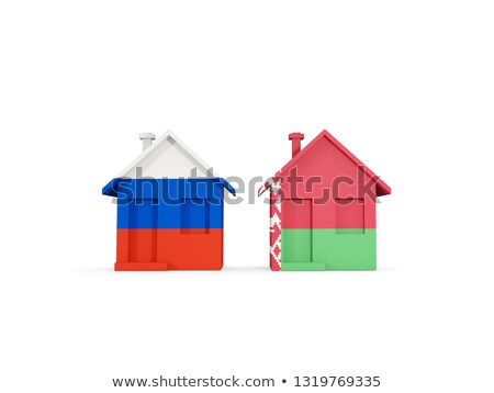 Two houses with flags of Russia and belarus Stock photo © MikhailMishchenko