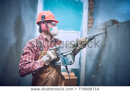 Builder works with a drill Stock photo © netkov1