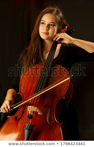 Lonely composer playing on cello Stock photo © ra2studio