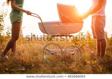 Stok fotoğraf: Man In Autumn Park Mother And Father With Pram