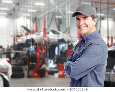 Smiling mature man repairing the car Stock photo © Kzenon