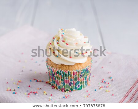 Cupcakes with white cream icing on blue wooden background Stock photo © Melnyk
