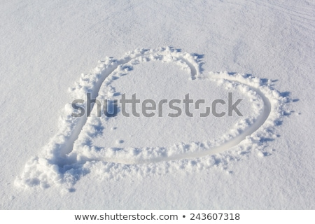 Heart shape drawn on white snow, love symbol Stock photo © caimacanul