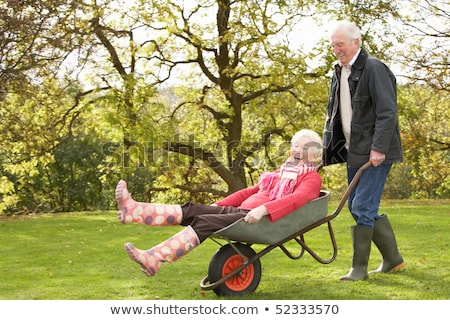 Senior Couple Man Giving Woman Ride In Wheelbarrow Stock photo © monkey_business