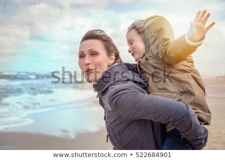 happy family running along autumn beach Stock photo © dolgachov