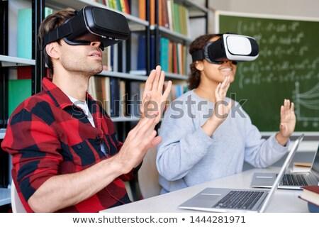 два Одноклассники темные очки прикасаться виртуальный Сток-фото © pressmaster
