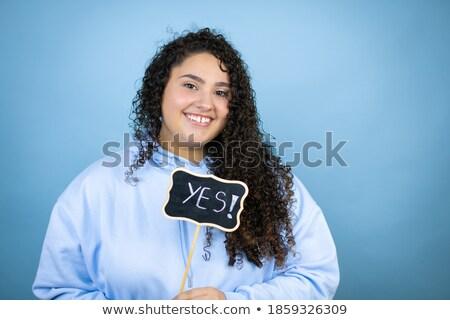 Casuale sorridere multiculturale ragazza guardando Foto d'archivio © pressmaster