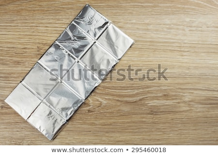 A pile of chocolates wrapped in the foil Stock photo © boggy
