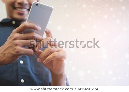 Businessman checking text messages on phone. Stock photo © lichtmeister