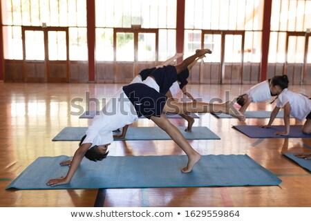 Oldalnézet iskolás gyerekek jóga pozició jóga matrac iskola Stock fotó © wavebreak_media
