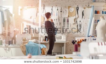 fashion designers drawing sketches at studio Stock photo © dolgachov