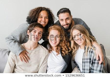Jovem afetuoso sorridente amigos sessão câmera Foto stock © pressmaster