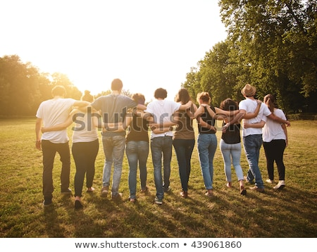 Group of friends in the park Stock photo © iko