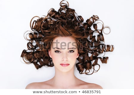Portrait of the beautiful young woman with ringlets hairs lying  Stock photo © Elmiko