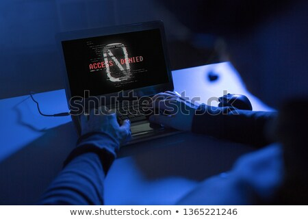 hacker with access denied message on laptop Stock photo © dolgachov