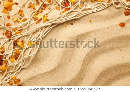 Ambers And Fishing Net Composition On Sand Stock photo © Bozena_Fulawka