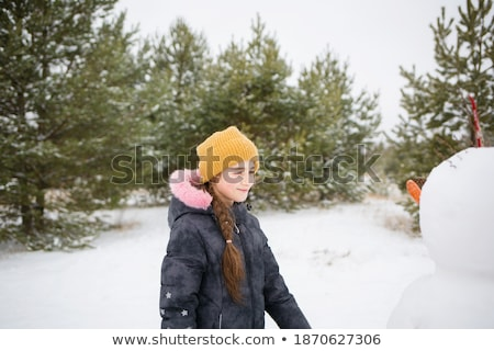 Kid Sculpting Snowman in Winter Park or Forest Stock photo © robuart