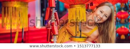 Woman celebrate Chinese New Year look at Chinese red lanterns. Chinese lanterns BANNER, LONG FORMAT Stock photo © galitskaya