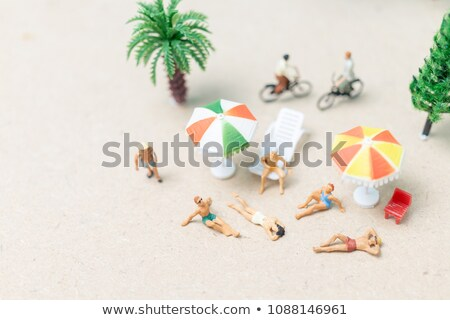 Minyatür adam mayo plaj rahatlatıcı Stok fotoğraf © nito