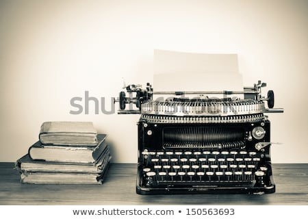 typewriter with old book Stock photo © pterwort