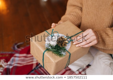 beautiful woman opening red present stock photo © Rob_Stark