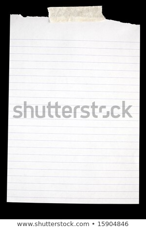 old torn white lined paper stuck to a black background stock photo © latent